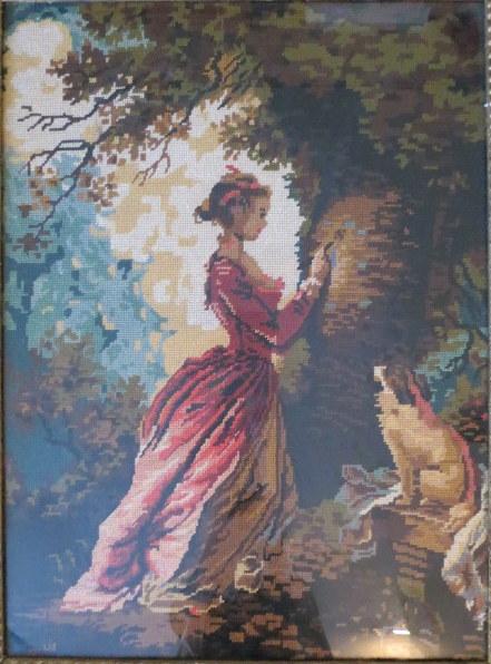 גובלן ממוסגר, מראה אישה עם כלבלב