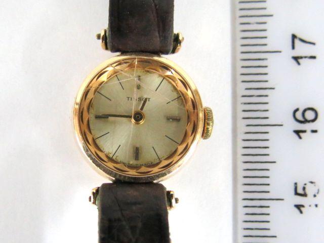 שעון יד תוצ Tissot, שוויץ קופסה זהב 14K , לאישה