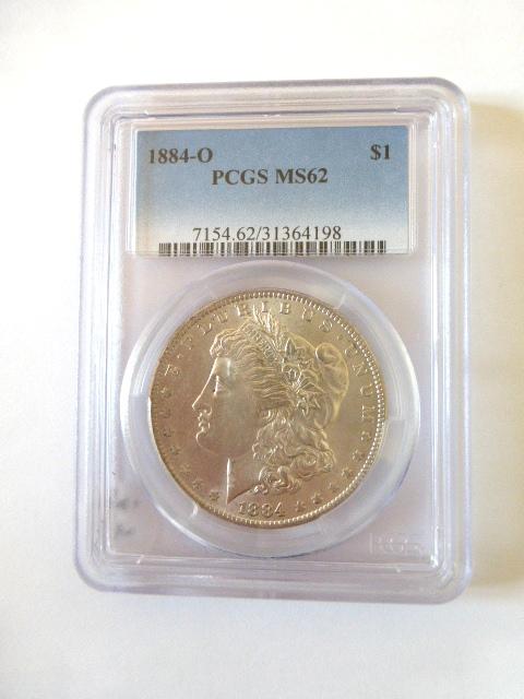 """מטבע כסף ע""""ס דולר Morgan Dollar 1884-O  PCGS-MS62 דירוג"""