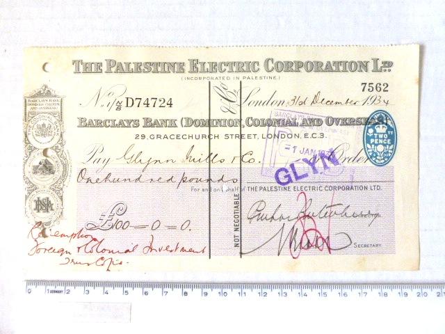 """צ'ק של חברת החשמל לארץ ישראל לונדון, 1934, ע""""ס 100 לא""""י, חתום ע""""י רוטנברג (חתימה אדומה)"""