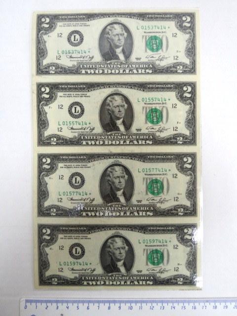 """ארבעה שטרות ע""""ס שני דולר ארה""""ב לא גזורים, מסדרת השלמות עם כוכבים, בלמינציה"""