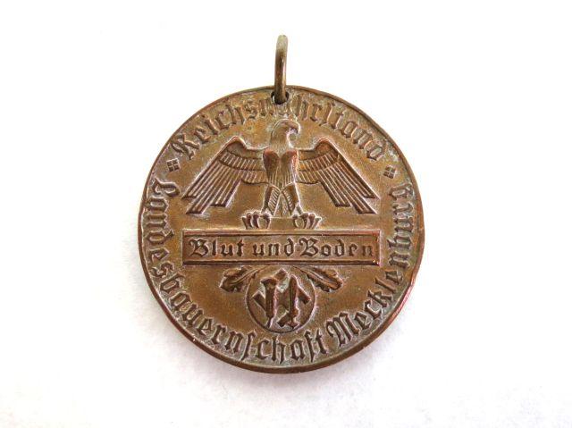 """אות אדמה ודם, ניתן לנאמנות של חקלאים גרסת Mecklenburg Blut und Boden, קוטר 3.9 ס""""מ"""