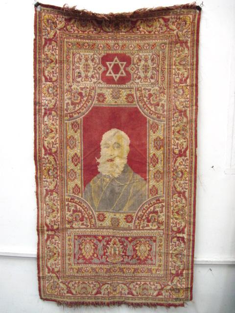 שטיח קיר עבודת מכונה, עם דיוקן מכס נורדאו (דהוי)