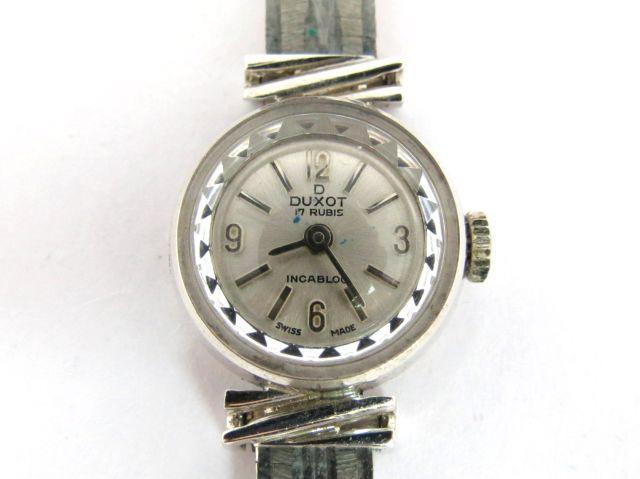 """שעון יד תוצ Duxot, שוויץ הקופסה זהב לבן 18K, הצמיד זהב לבן 14K, ס""""ה כ-13 גרם זהב"""
