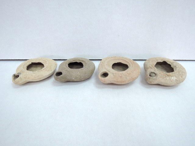 ארבעה נרות שמן מחרס, תקופה רומית, מאות ראשונה ושניה לספירה, דיסקוס שבור