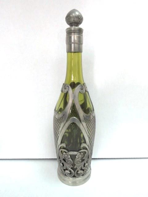 בקבוק עם חיפוי פיוטר