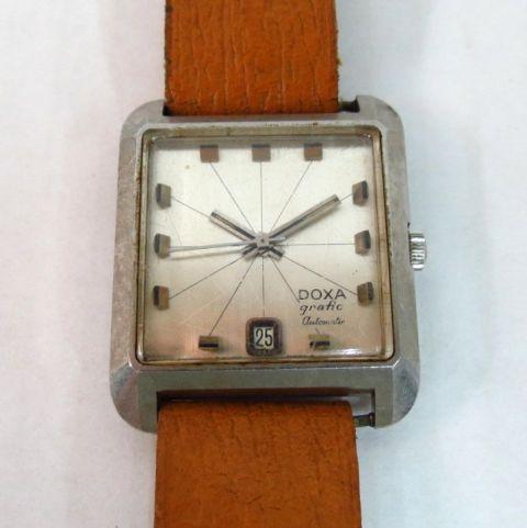 שעון יד תוצ Doxa, שוויץ דגם Grafic, עם תאריך, מנגנון אוטומאטי