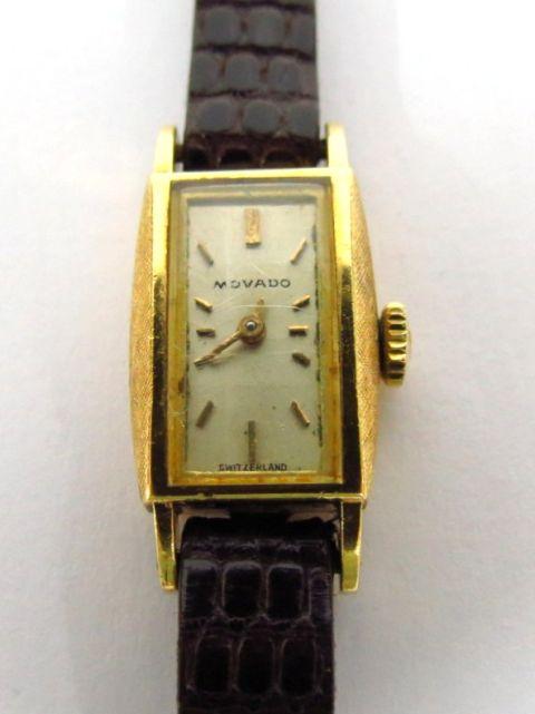 שעון יד תוצ Movado הקופסה זהב 18K, לאישה
