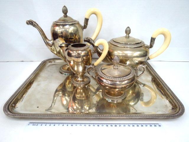 סרוויס קפה, כסף 800 הכולל: קנקן קפה, קנקן תה, כלי לסוכר וכלי לחלב (עם ידית בקלייט), פייה דוגמת דרקון, ומגש,