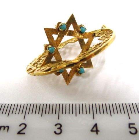 תליון זהב עם מגן דוד, משובץ ב-6 רובינים וששה טורקיזים